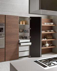 Sleek clean lines with floor to ceiling cabinetry doors. Great look and great way to #cuttheclutter #qca