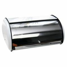 "Keep your homemade rye and whole-grain loaves fresh with this essential bread box, crafted from stainless steel and featuring a sliding door.    Product: Bread boxConstruction Material: Stainless steelColor: Black and silverFeatures: Upward sliding front doorDimensions: 7"" H x 16.5"" W x 10.5"" D"