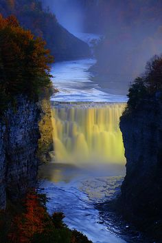 """Letchworth State Parks middle falls (one of three) on the Genesee River in western New York. Area includes """"pavilions, picnic tables, a playground, hiking trails, two large swimming pools, cabins, campsites for tents, trailer sites with dumping stations, and horse-riding trails"""""""