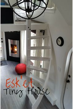 Esk'et Tiny House - spiralling stair to sleeping loft, fireplace, sphere chandelier, grey oak floor, white walls, red pop of color! 280sq ft house, built at Alkali Lake, British Columbia, Canada - Youtube video series! www.eskettinyhouse.com
