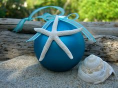 I think this could be an easy DIY gift!     Christmas Ornament-Starfish Deep Ocean Blue-Starfish Ornament, Beach House Decor, Holiday Ornaments, Teacher Gifts, Coastal Holiday Decor. $12.95, via Etsy.