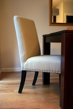 How to recover old fake leather dining chairs with new fabric covers and nailhead trim