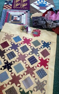 Nice 2 block quilt:  it's a sawtooth star block with half square triangle corners,  added the economy square for the alternate block
