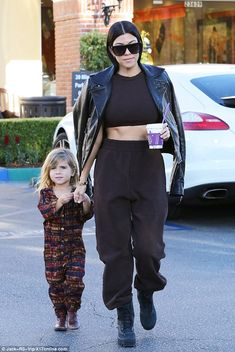 Hot mama! Kourtney Kardashian was spotted at Color Me Mine with her daughter Penelope, three, in Calabasas on Monday