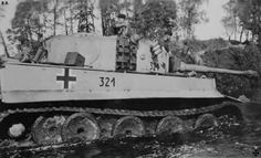 A Tiger 1 Ausf H with the sPzAbt. 502 is out of action after mistakingly driven into a deep marsh area during 1943.