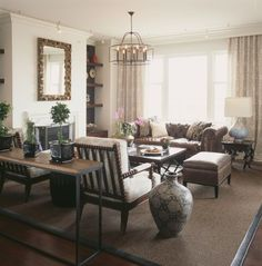 Neutral color palette with a taupe leather Chesterfield sofa creates a comfortable sitting room.