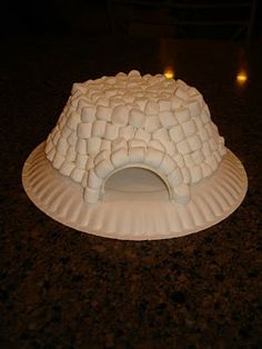 Elf builds a marshmallow igloo