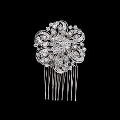 """Bridal Hair Comb with Crystal Flower.  This richly embellished floral design adds sparkle to your wedding look.  3.25"""" x 2""""."""