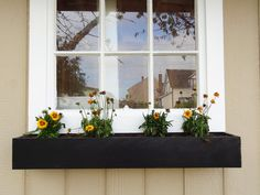 Build a Modern Window Planter Box  This simply designed, easy-to-construct and inexpensive DIY window box can give your home or shed just the right touch of color