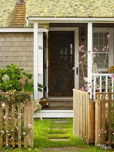 A double layer of doors offers options when the weather warms up or cools off. Here, a white, barn-style door opens to reveal a screen door -- all the better to admit air, the fragrance of flowers from the garden, and birdsongs.