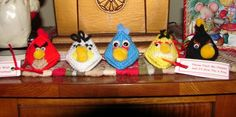 For Christmas or anytime, plastic canvas, yarn, pom poms and googly eyes become Angry Birds, just big enough to hold one Hershey's kiss.  The idea comes from a 1987 craft  book called Kiss'n Critters by Mildred Melton and Susie Hamilton.