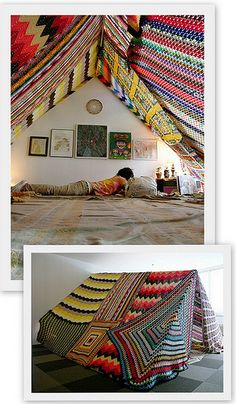 Indoor tent made with beautifully colored blankets makes a fun, cozy space.