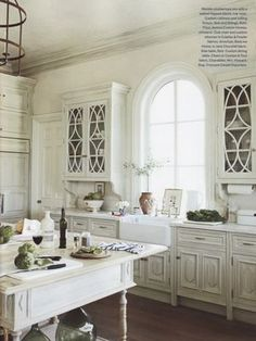 arched window in whitewashed kitchen  / Pheobe Howard