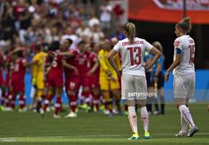 Switzerland midfielder Ana Maria Crnogorcevic (L) and teammate Caroline Abbe watch Canada celebrate their win during the round of 16 football match between Canada and Switzerland at BC Place Stadium in Vancouver during the FIFA Women's World Cup Canada 2015 on June 21, 2015. AFP PHOTO/ANDY CLARK