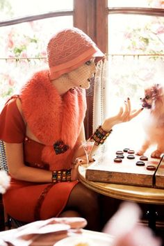 I love everything about this photo, the clothes, the checkers-playing-Pom, and oh, that coral color!