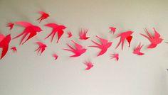 Birds on a wall.