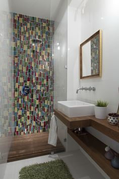 colorful small bathroom, tiles on the shower wall, Pataki tiles, modern interior, colorful interior