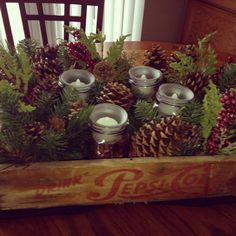 Crate rustic Christmas centerpiece with Mason jars..