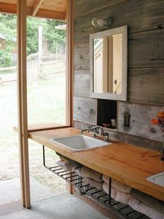 wood countertop for  the  bathroom with nice storage