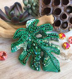 Hey, I found this really awesome Etsy listing at https://www.etsy.com/listing/555753453/brooch-green-color-monstera-leaf-beaded