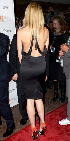 Gwyneth Paltrow's sheath is deceptively demure in the front, sexy in the back http://www.peoplestylewatch.com/people/stylewatch/package/gallery/0,,20417681_20590676_21213370,00.html#