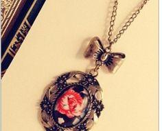 Rosa Vintage R$35,75 Pingente com uma rosa no estilo vintage!