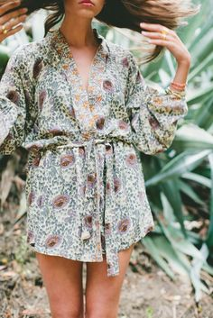 3/4 sleeve, belted short kimono. Perfect for a lightweight robe or wear as top over skinny jeans. 100% VISCOSE