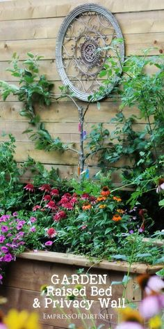 This project combines a large, raised garden bed with a privacy wall to create a…