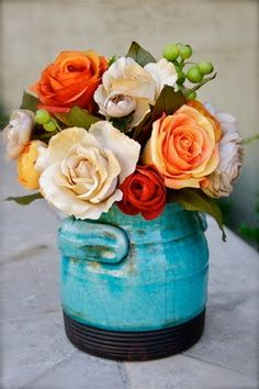 Gorgeous turquoise pot. Love the roses and berries together.