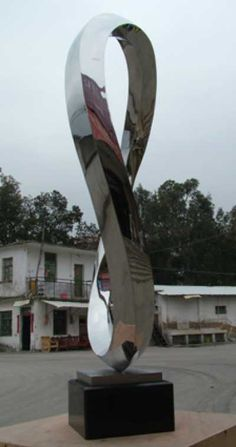 Stainless steel and granite Garden Or Yard sculpture by artist Wenqin Chen titled: 'Endless Curve No.3'