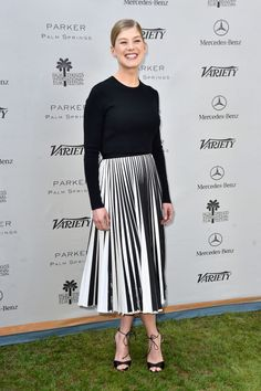 Rosamund Pike We're telling you: Sweaters and skirts are where it's at.