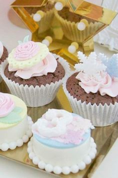 Don't miss the sweet Disney princess-inspired cupcakes and chocolate covered cookies at this Disney princess birthday party! See more party ideas and share yours at CatchMyParty.com #catchmyparty #partyideas #4favoritepartiesoftheweek #princess #disneyprincess #disneyprincessparty #princesscupcakes