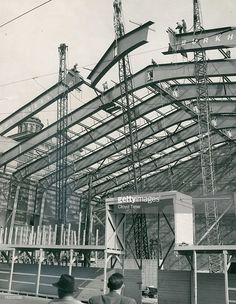 SEP 15 1950; The final section of the last arch which is to support the roof of the new city auditorium annex was hoisted into place Thursday afternoon by employes of the Burkhardt Steel company. The nine-ton center section was lifted into place with the aid of a 73-ton crane. Each of the six new arches weighs a total of seventy-one tons and is made up of five separate sections, two uprights, two horizontal beams and a center section. Each of the uprights weighs fourteen tons, the…