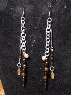 tigers eye, feather charms long earrings. $15.00, via Etsy.