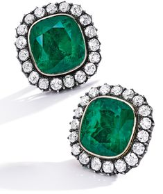 Pair of emerald and diamond ear clips, Cartier. Each set with a cushion-shaped emerald stated to weigh and carats respectively, within a frame of circular-cut diamonds. Diamond Earing, Diamond Brooch, Diamond Bangle, Pearl Jewelry, Antique Jewelry, Fine Jewelry, Modern Jewelry, Vintage Jewelry, Cartier