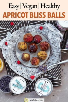 Delicious apricot bliss balls which are decorated with chocolate, powders and flowers for the holiday season. Here's how to make the bliss balls with apricots and walnuts. Click to read the recipe #recipe #vegan #vegansnack #veganfood