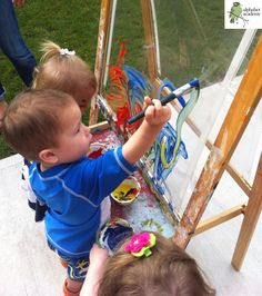 A great outdoors activity — painting on clear plastic — Alphabet Academy North Toddlers http://thealphabetacademy.com