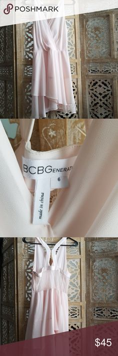 Blush pink BCBGeneration dress My daughter wore twice, looks like something a ballerina would wear. Sexy but sophisticated top with a flowy skirt accented by lace peeking from under skirt and the back. BCBGeneration Dresses