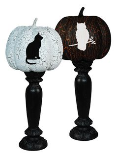 Great for Halloween, carve some nocturnal or spooky animals and images into a pumpkin and paint it a cracked black and white. I love that they are resting on candle stands too.