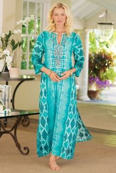 """$148 Nyoman Caftan from Soft Surroundings - hand-sewn embellishment - silver seed beads, turquoise faceted """"jewels,"""" unique pompom beads and white roping - light up the neckline of this exotic caftan, fashioned in a stunning ikat print with contrasting designs in vibrant turquoise. Cool and lightweight with high side slits, it's ready for lounging or entertaining. Due to their artisanal origin, no two are alike. Cotton. Women 54"""" long."""