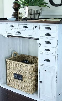 This piece is an old watchmakers cabinet. I painted it using Miss Mustard Seed's milk paint in Ironstone. Then waxed and distressed.