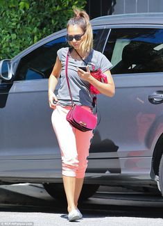 Pretty in pink: Jessica Alba worked out at the gym in stylish pink track trousers and a grey T-shirt on Tuesday