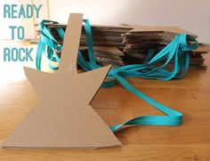 Paper guitars make into craft for kids to do at party!