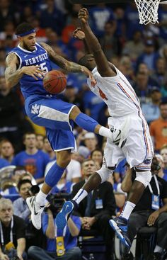 Kentucky forward Willie Cauley-Stein (15) and Florida center Patric Young (4)