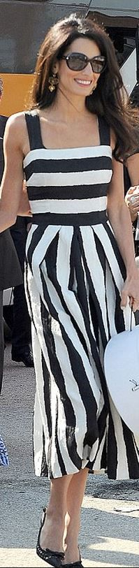 Who made Amal Alamuddin's black pumps, gold jewelry, and white stripe dress that she wore in Venice