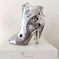 Giuseppe for Thakoon Mirror Mosaic Ankle Boots Price firm & no trades. Brand new never worn Giuseppe Zanotti for Thakoon Mirror Mosaic Ankle Boots. Silver mirror mosaic-style leather peep-toe ankle boots with a heel that measures approximately 110mm/ 4.5 inches. Thakoon ankle boots have cutout detailing, an exposed silver-tone zip fastening at front and back and a jagged finish at top. Some of the leather has wrinkled a bit over time. Giuseppe Zanotti Shoes