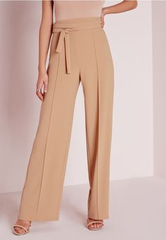 Get a super sophisticated evening look suitable for any occasion. These super easy crepe wide leg pants feature an attached tie belt at the waist. We're teaming these camel beauts with a white shirt, camel coat and strappy heels for simple ...