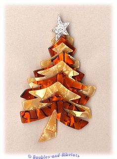 Christmas Tree Brooch by Lea Stein...I love my green one without the star...but diggin' this orange one with silver star!