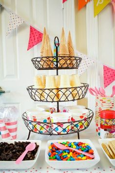 If you're graduating in the summer, an ice cream bar is the perfect way to help your guests cool down. Decorate a three-tiered serving stand with a variety of cones and patterned cups. Surround it with candy dishes filled with toppings and colorful utensils. Find this idea on Pinterest.   - Seventeen.com