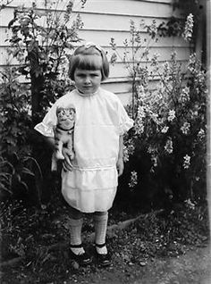 Girl with toy cat, 1926